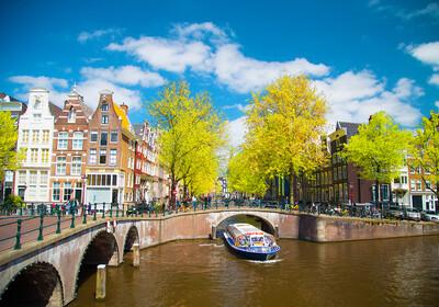 Vožnja brodom po amsterdamskom kanalu, putovanje u Amsterdam
